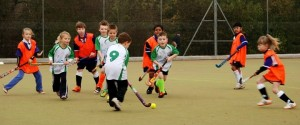 Under 8s juniors in hockey match action